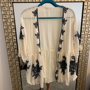 Sheer cardigan with blue flower detail